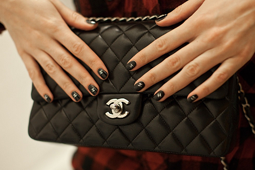 cute-chanel-stickers-on-a-black-nail-polish